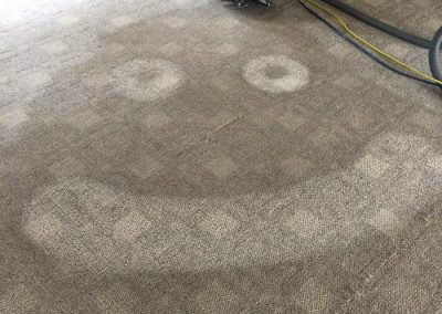 a smiley faced we cleaned into a dirty carpet before finishing the job