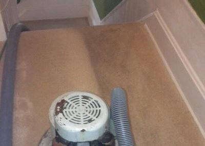 a chem-dry carpet cleaning machine cleaning up stairs